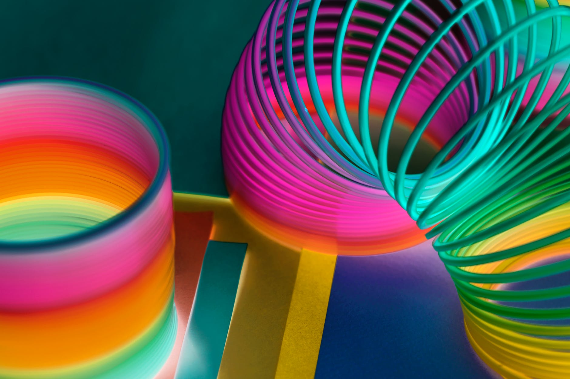multicolored plastic slinky toy in close up photography