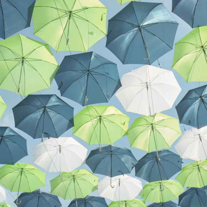hanged green white and gray umbrellas